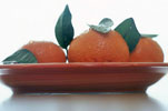 Three Whole Tangerines on a Plate